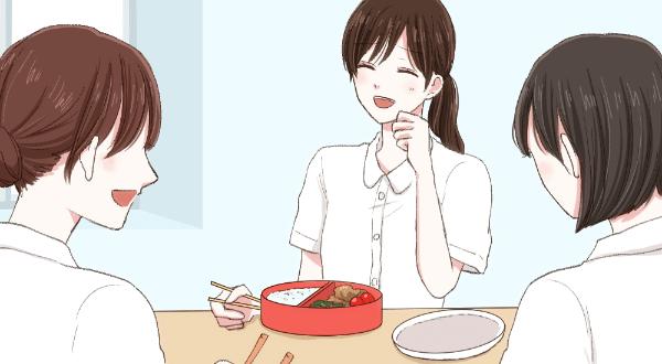 弁当を食べながら同僚と談笑