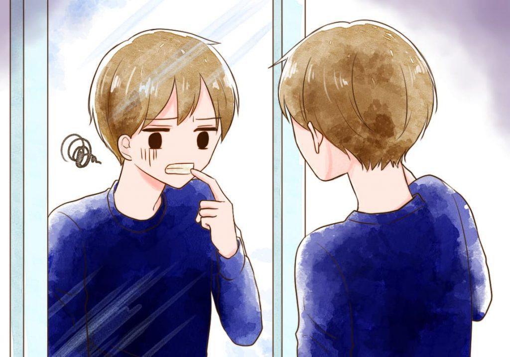 鏡の前で歯を見ている人